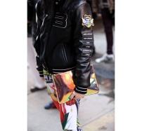 leather bomber and orange mirror clutch @ vogue.fr